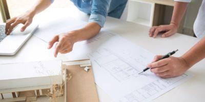 architect-working-on-blueprint-8BPGNP8-min